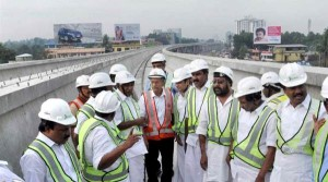 E. Sreedharan with Oomen Chandy on top of Kochi's Metro line - Photo Copyright Indian Express