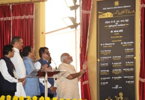Narendra Modi unveiling the plaque to lay the foundation stone -  Press Information Bureau, Govt of India