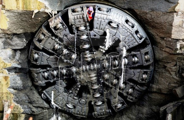 A worker emerges from inside - Photo Copyright: European Pressphoto Agency
