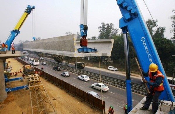 U-girder being erected on Delhi's Airport Express line - photo copyright First Post