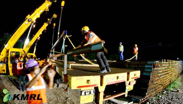 Tracks being hoisted onto a trailer - Photo Copyright KMRL