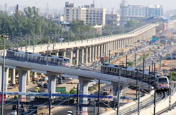 Two trains cross each other at the Badarpur border between Delhi & Faridabad - Photo Copyright HT - Getty Images