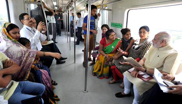 Narendar Modi inside the Delhi Metro on the way to inaugurate the Faridabad Metro line - Photo Copyright: Rediff