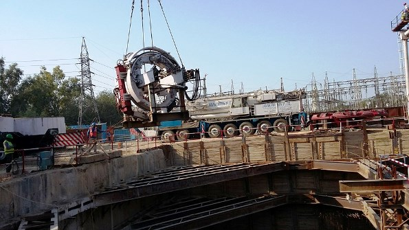Segment erector being lowered into the shaft - Photo Copyright: Ravinder Rawal